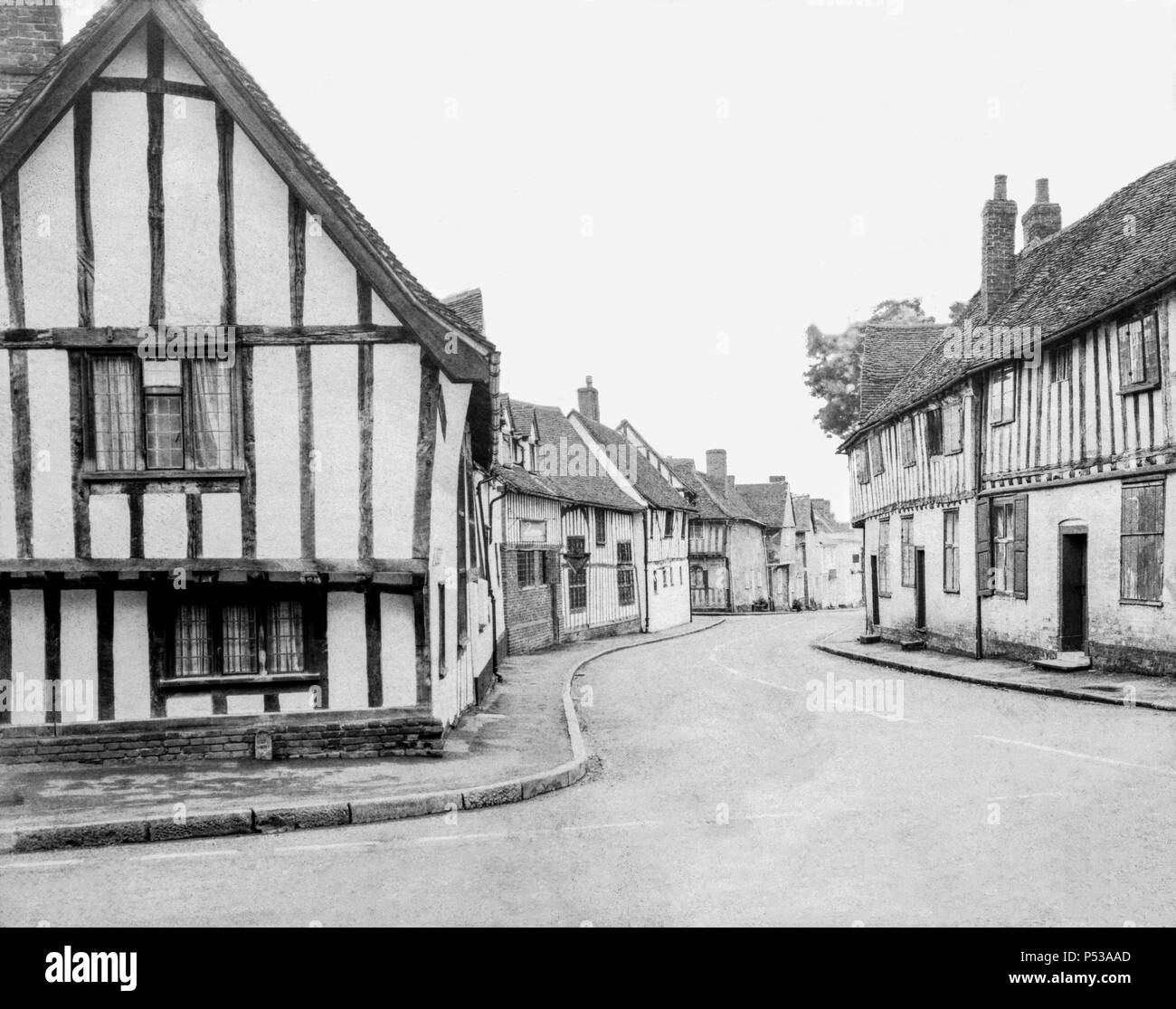 Half-timbered medieval buildings (The Swan Hotel & Water Street) in Lavenham, Suffolk UK taken on a paper negative on a 5x4 camera around 1972. - Stock Image