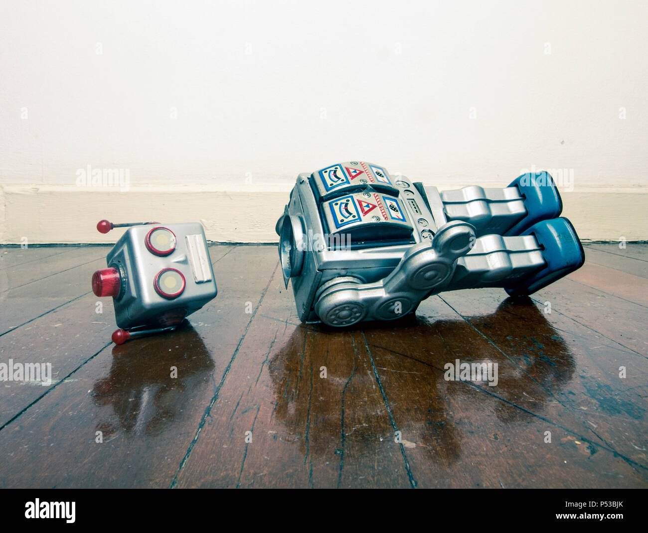 vintage bot lost his head on a old wooden floor with reflection - Stock Image