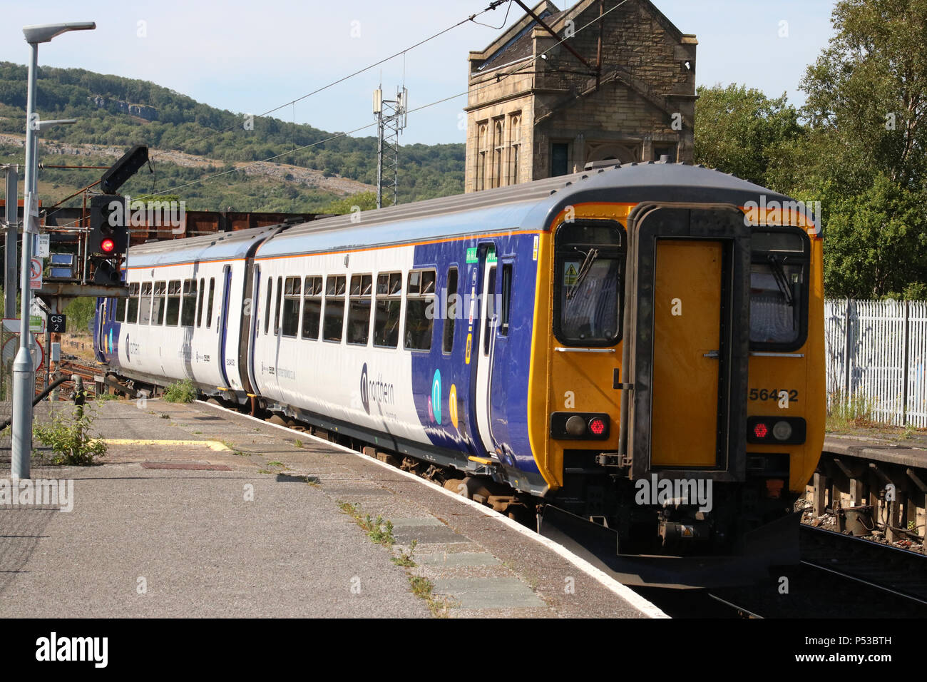 Class 156 super sprinter dmu in Northern livery leaving Carnforth railway station with service to Carlisle via Barrow-in-Furness and Cumbrian Coast. - Stock Image