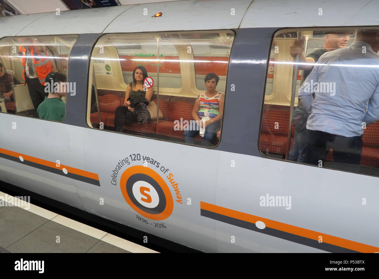 Passengers on the Glasgow subway, SPT underground railway, city centre train / railway, Strathclyde, Scotland, UK - Stock Image