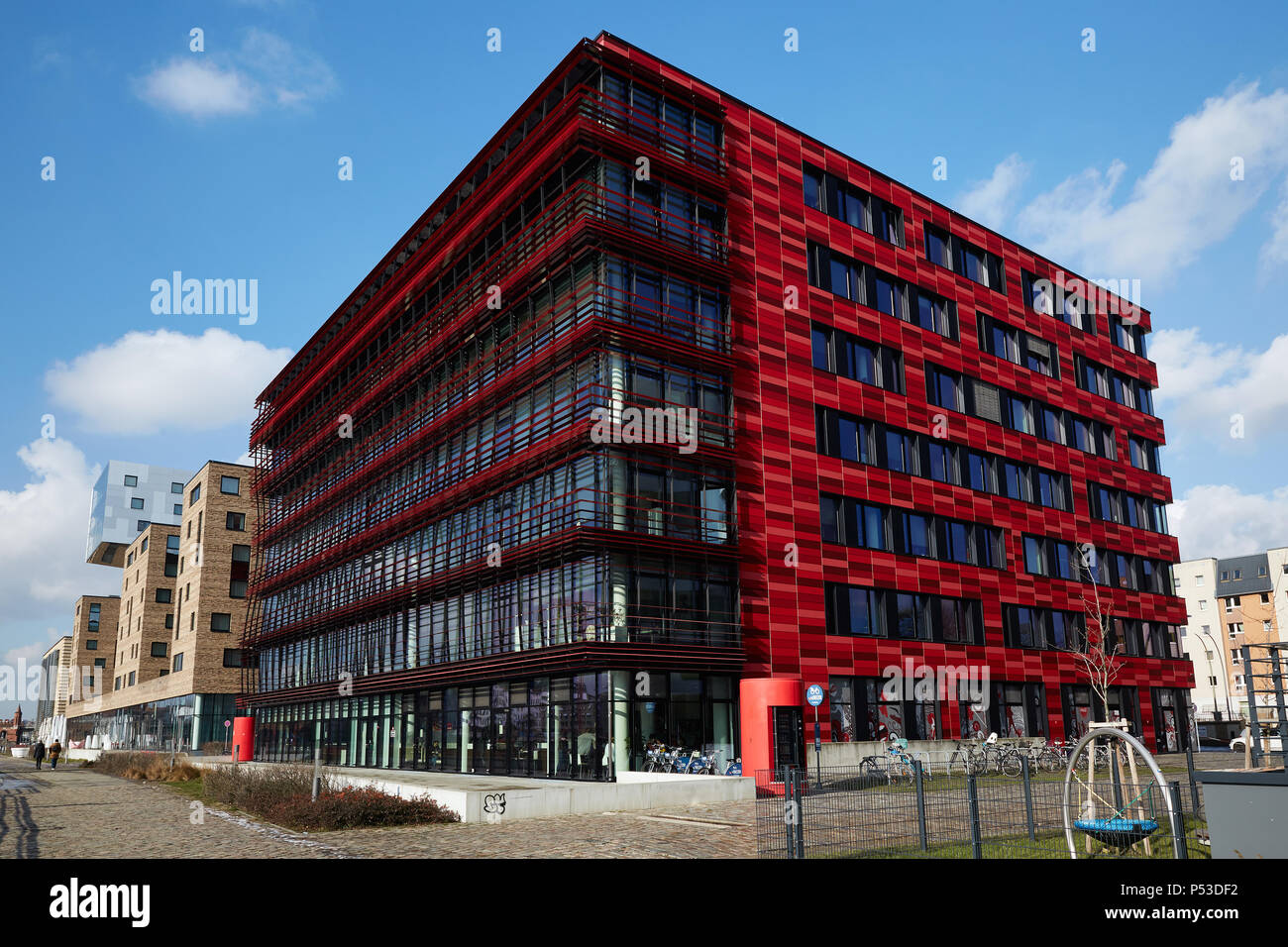 Berlin, Germany - The corporate headquarters of Coca-Cola Germany, behind the hotel nhow on the banks of the Spree in Berlin-Friedrichshain. - Stock Image