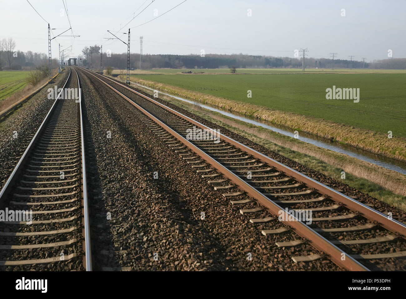 Schoenwalde, Brandenburg, Germany - View from the driver's station of a regional train on a two-lane railway line. - Stock Image