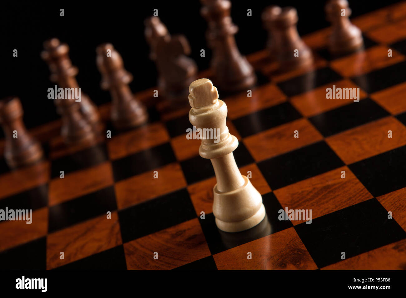 chess pieces with the king in the center - Stock Image