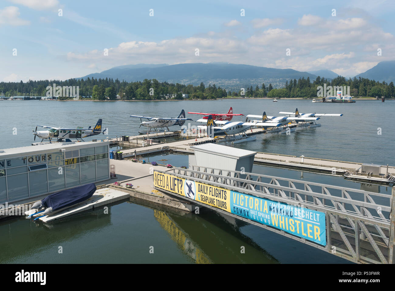 Seaplanes docked at Vancouver Harbour Flight Centre, a Seaplane Terminal located in Coal Harbour. - Stock Image