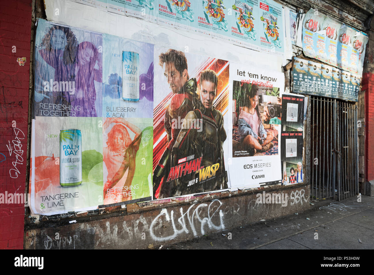 Bill posted on an old derelict building advertising of various products and events, Vancouver, BC - Stock Image