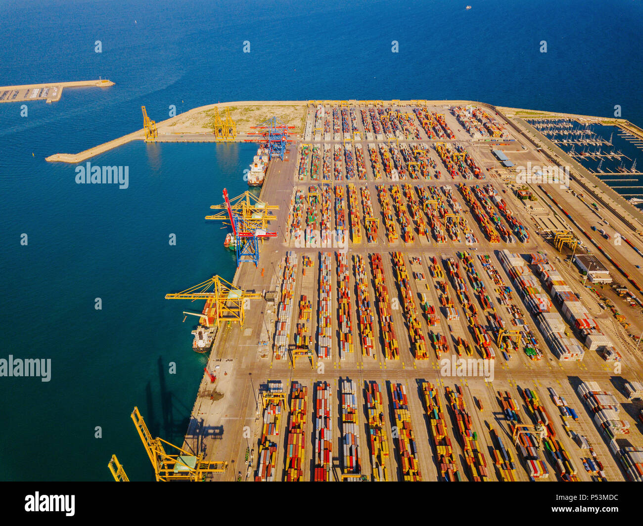 Aerial view of the commercial port of Valencia. Container terminal and ship during loading - Stock Image