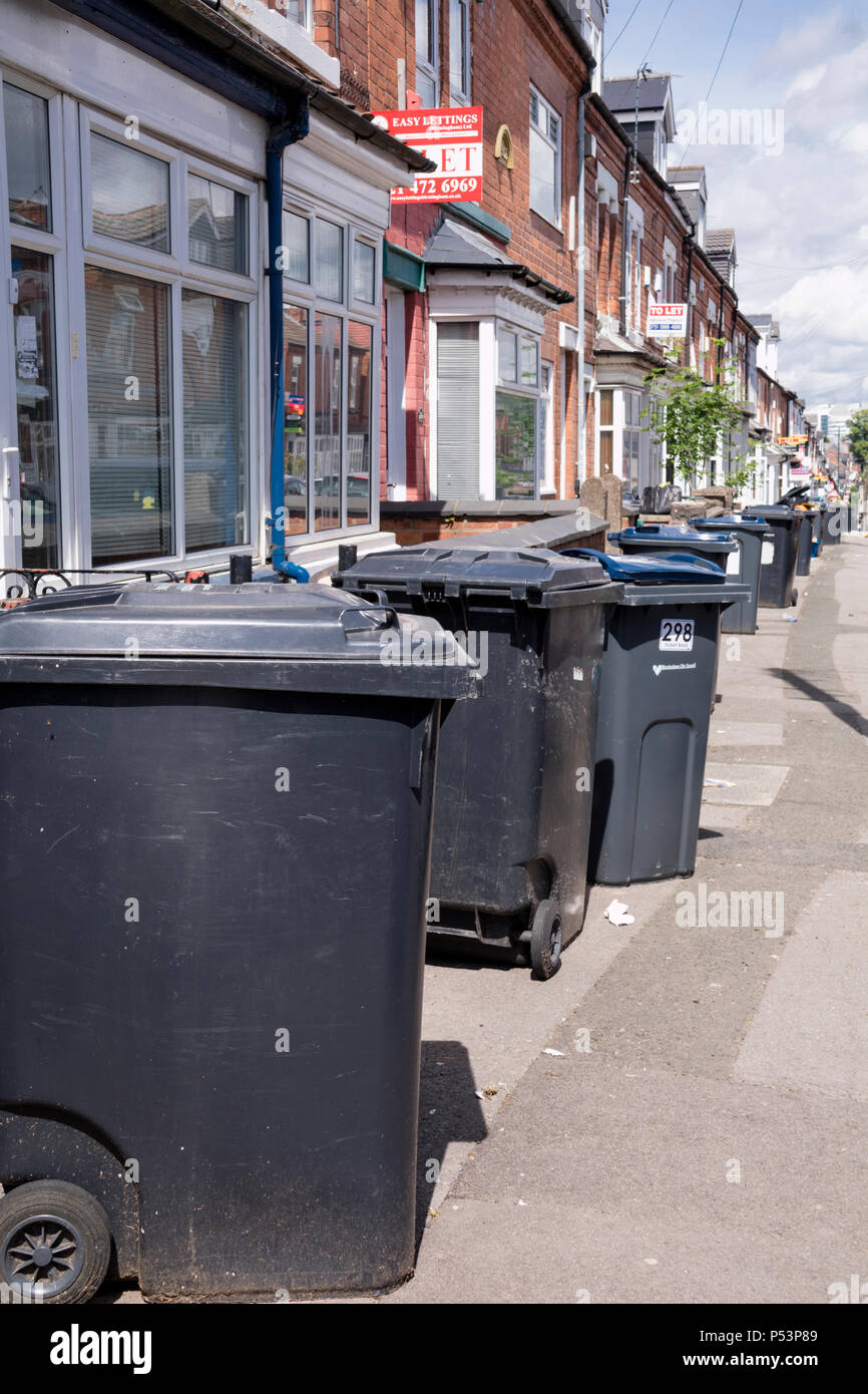Wheelie bins outside homes on a English street, England, UK - Stock Image
