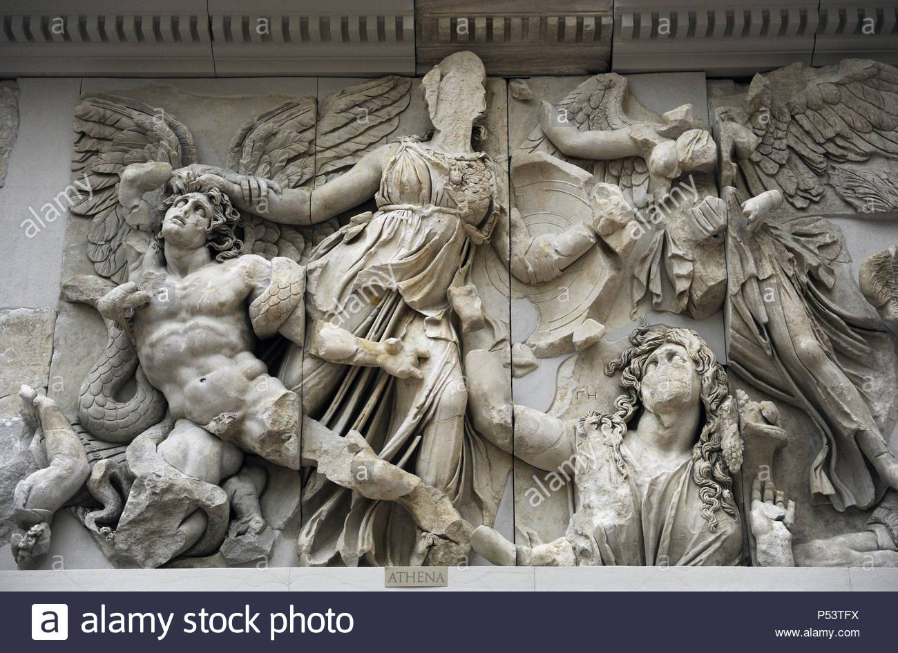 Pergamon Altar. Built by order of Eumenes II Soter. 164-156 BC by artists of the school of Pergamon. Marble and limestone. East frieze. Gigantomachy. Struggle between gods and giants. Athena taking the young Alcyoneus by the hair while his mother, Gaia, leaves the ground due to the death of his son. Next, the winged Nike.  Pergamon Museum. Berlin. Germany. - Stock Image