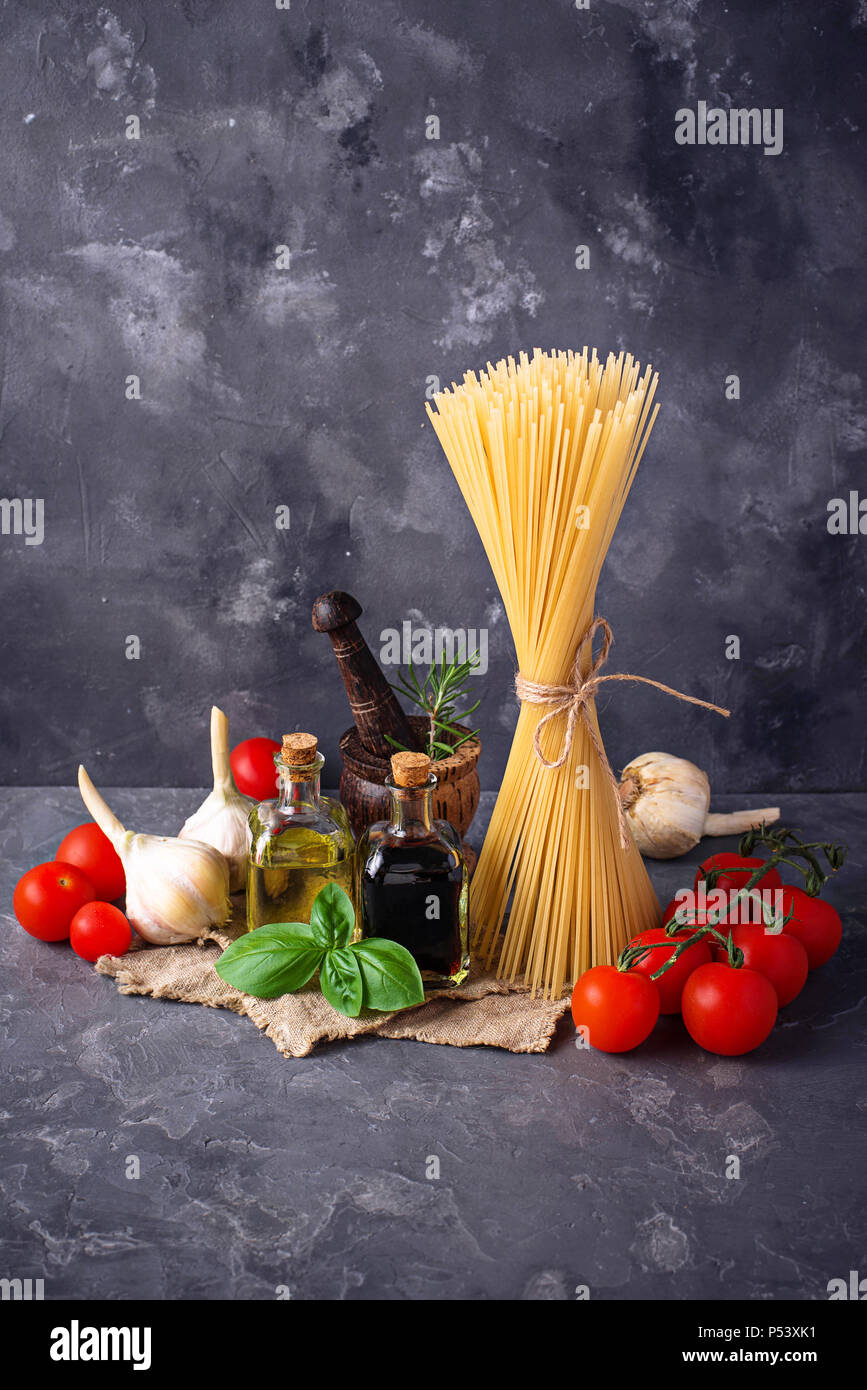 Pasta, tomatoes, olive oil and vinegar - Stock Image