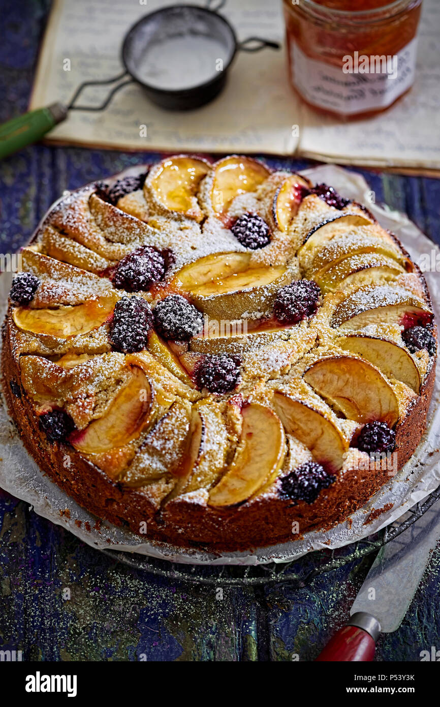 Apple and blackberry cake with icing sugar - Stock Image