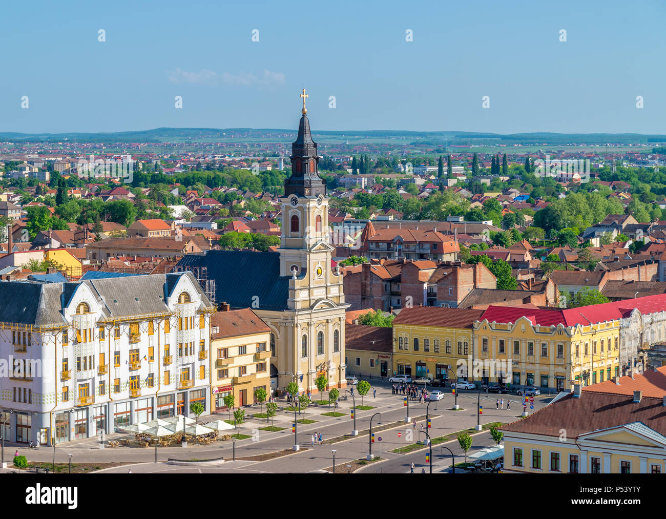 ORADEA, ROMANIA - 28 APRIL, 2018:  Church with the moon in the Union Square viewed from above in Oradea, Romania. - Stock Image