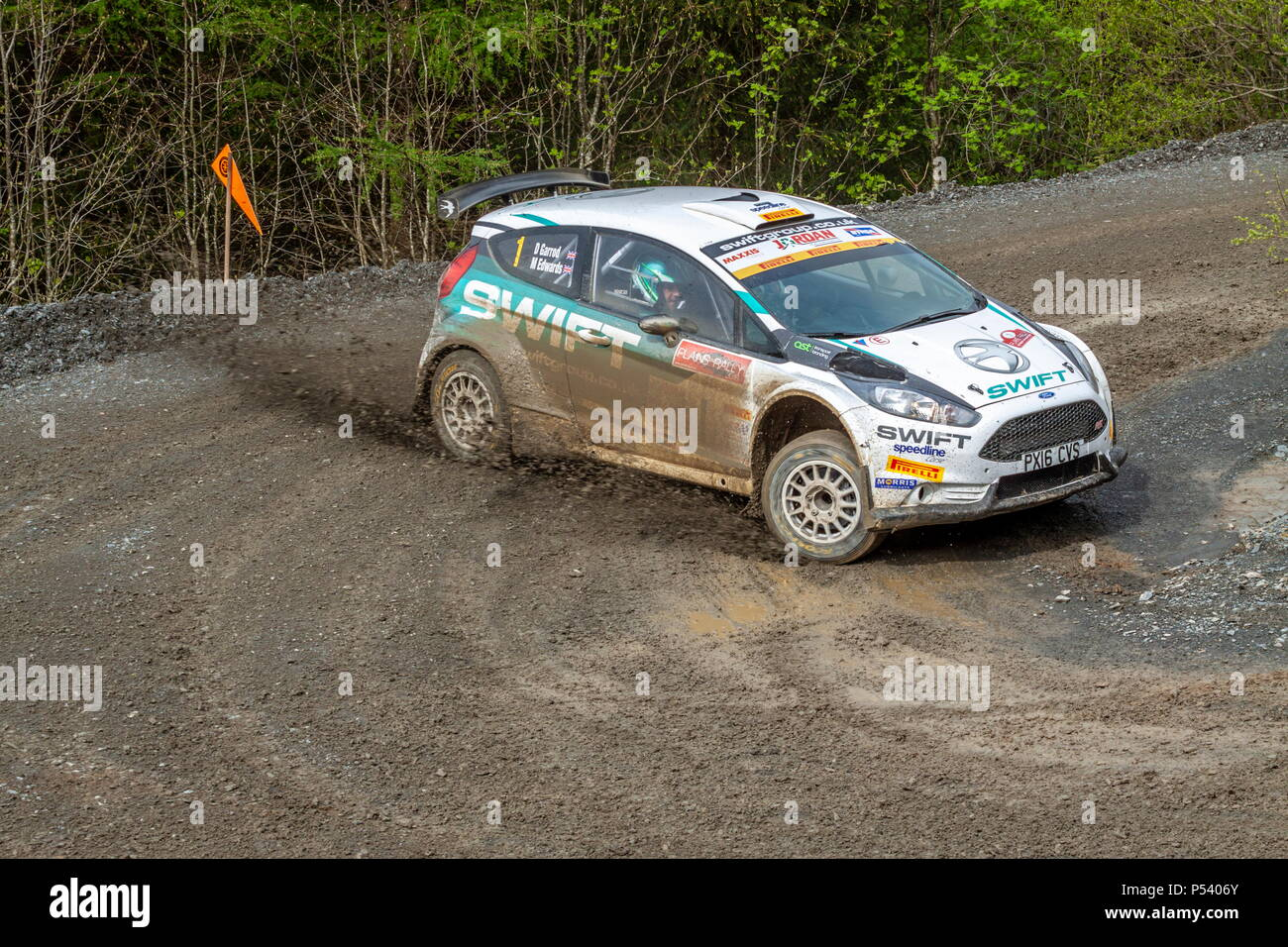 A Ford Fiesta rally car taking a corner on the Plains Rally in North Wales - Stock Image