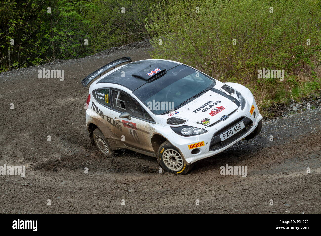 A Ford Fiesta rally almost crashes on a corner on the Plains Rally in North Wales - Stock Image