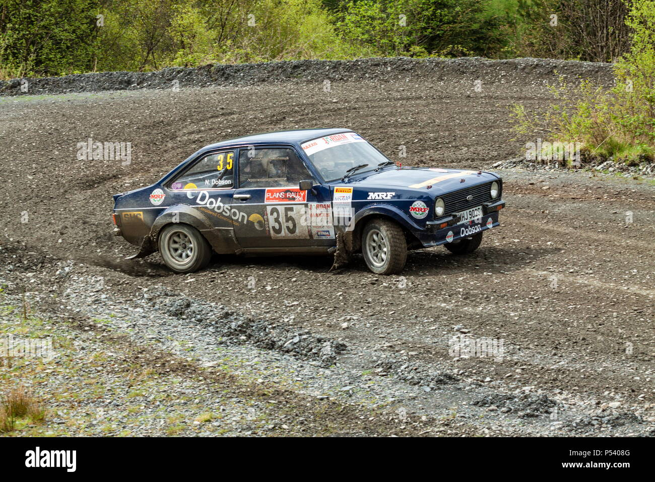 A Ford Mkii Escort rally car taking a corner on the Plains Rally in North Wales - Stock Image