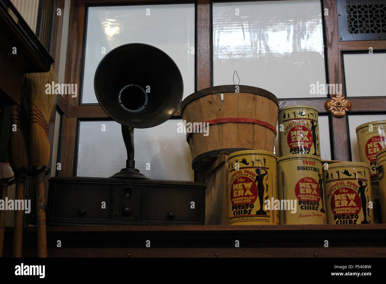 Variety of items such as a vintage megaphone and baskets for sale in the meat market grocery store at Glenview Park District's working Wagner Farm in suburban Chicago, Illinois. - Stock Image