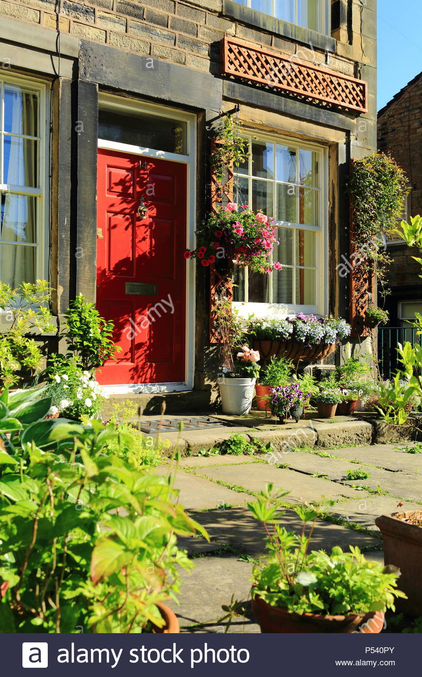 Beautiful Stone Cottage Surrounded By Summer Plants In The Quirky Village Of Dobcross, Saddleworth, Oldham, England Summer June 2018 - Stock Image