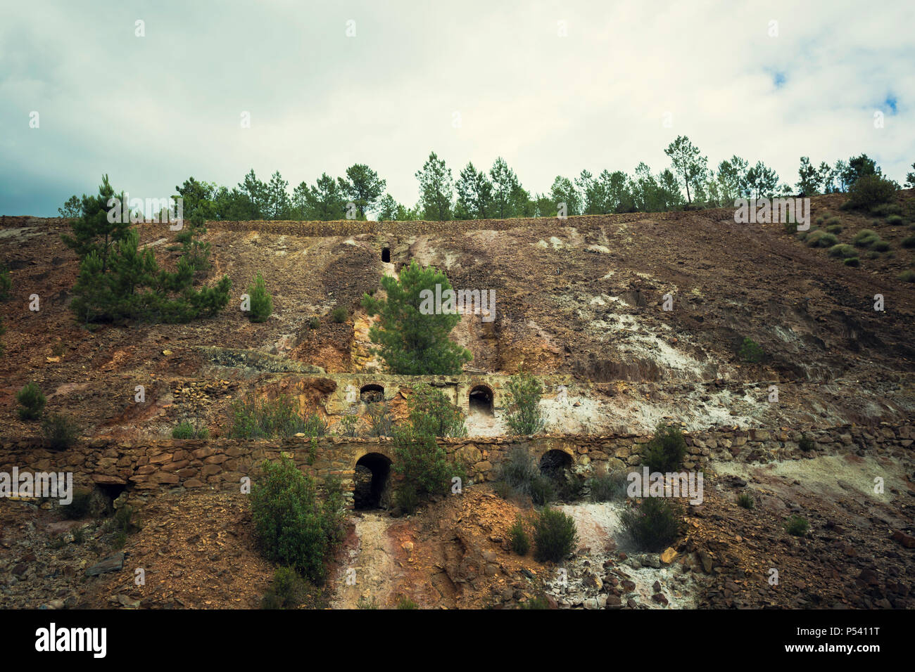 Landscape of old stone walls and arches in old copper mine in Zaranda, Spain - Stock Image