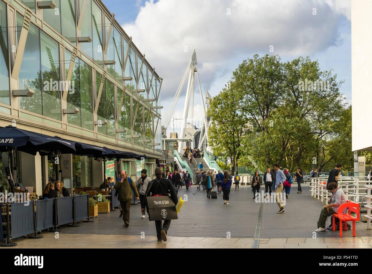 London Great Britain, October 12 2017, People walking on Golden Jubilee Bridge, Nice sunny autumn day in the city Stock Photo