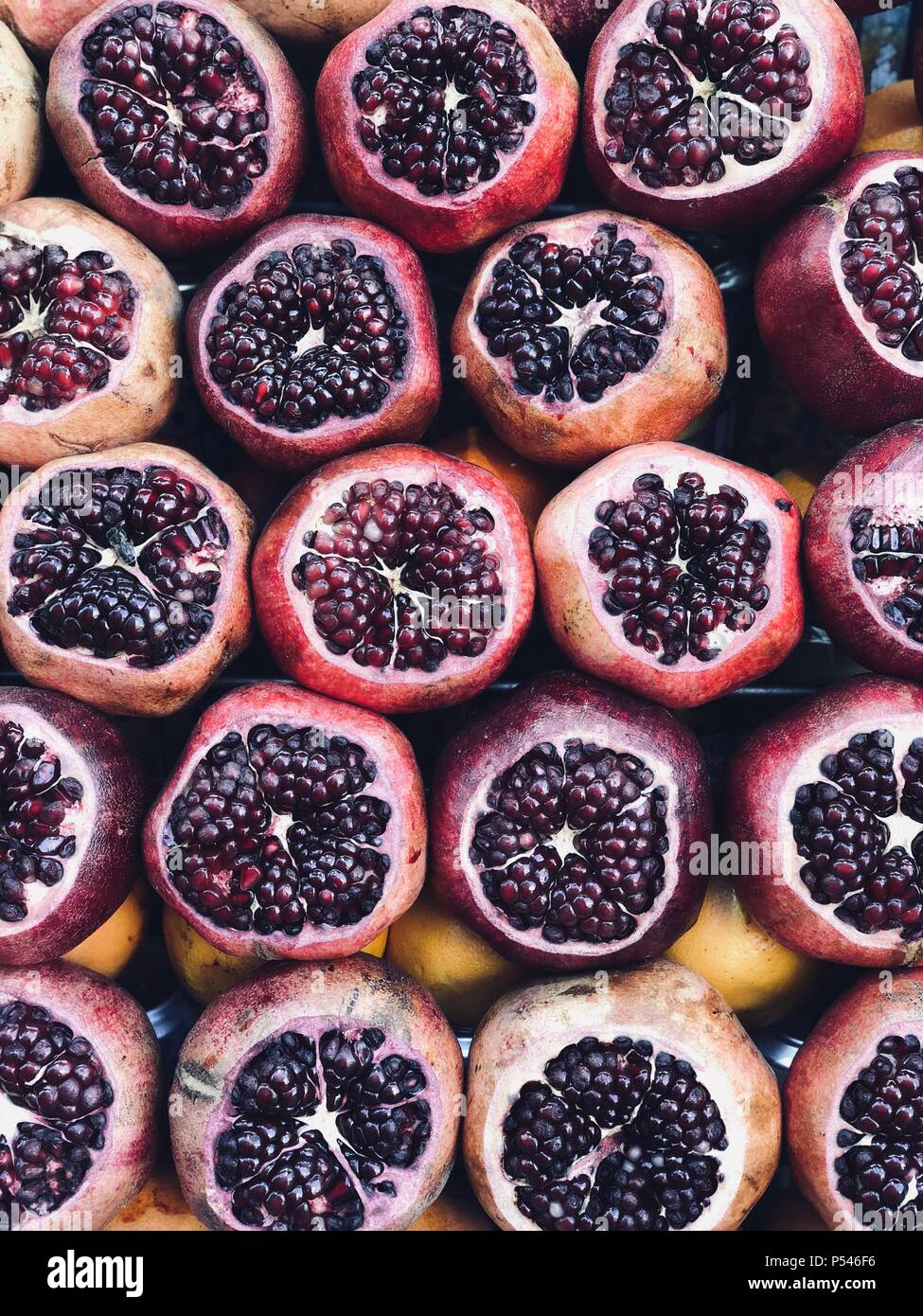 Pomegranates for making fresh juice - Stock Image