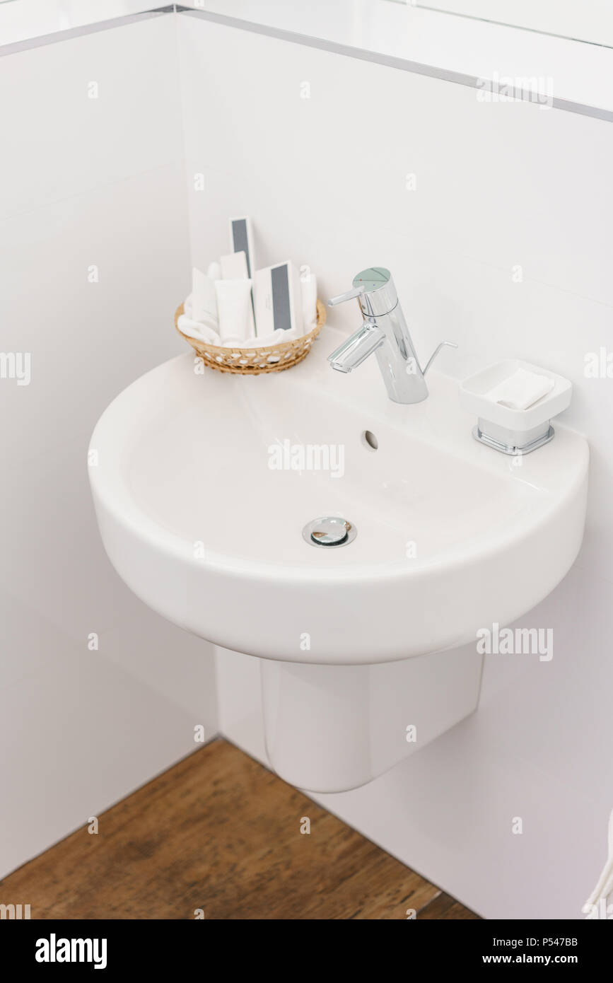 Bathroom Inside Rooms Of A Apartment Or Hotel. Clean White Sink