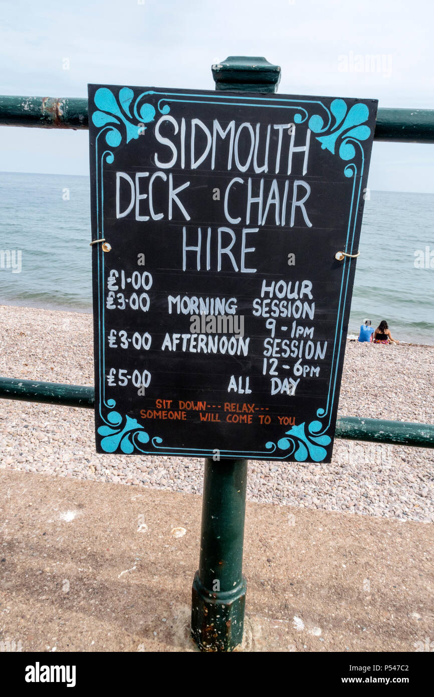 Sign showing the cost of deck chair hire in Sidmouth, Devon, 2018. - Stock Image
