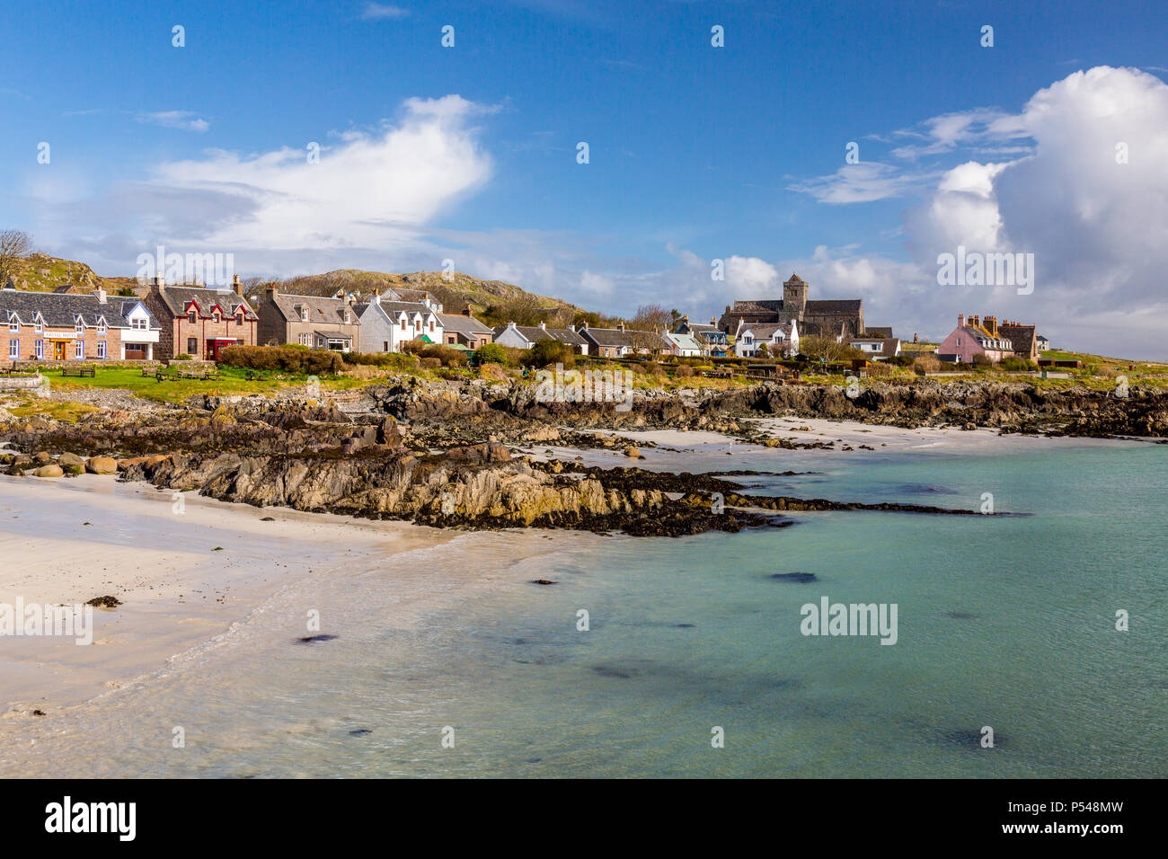 The village of Baile Mor and the historic Abbey on the Hebridean island of Iona both overlook the Sound of Iona, Argyll and Bute, Scotland, UK - Stock Image