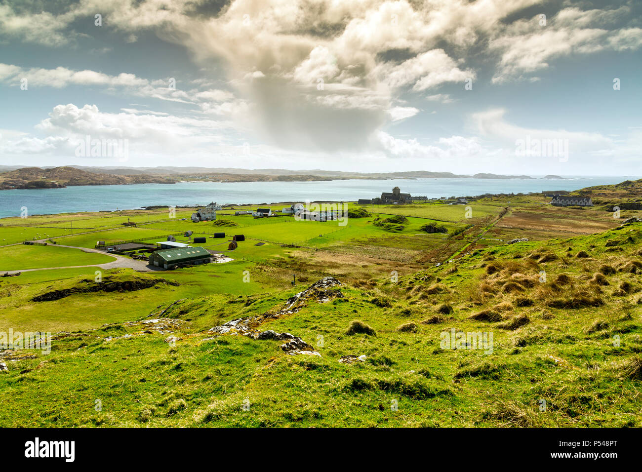 Cumulonimbus clouds over the Sound of Iona, viewed from Dun I (101m) the highest point on the Hebridean island of Iona, Argyll and Bute, Scotland, UK - Stock Image