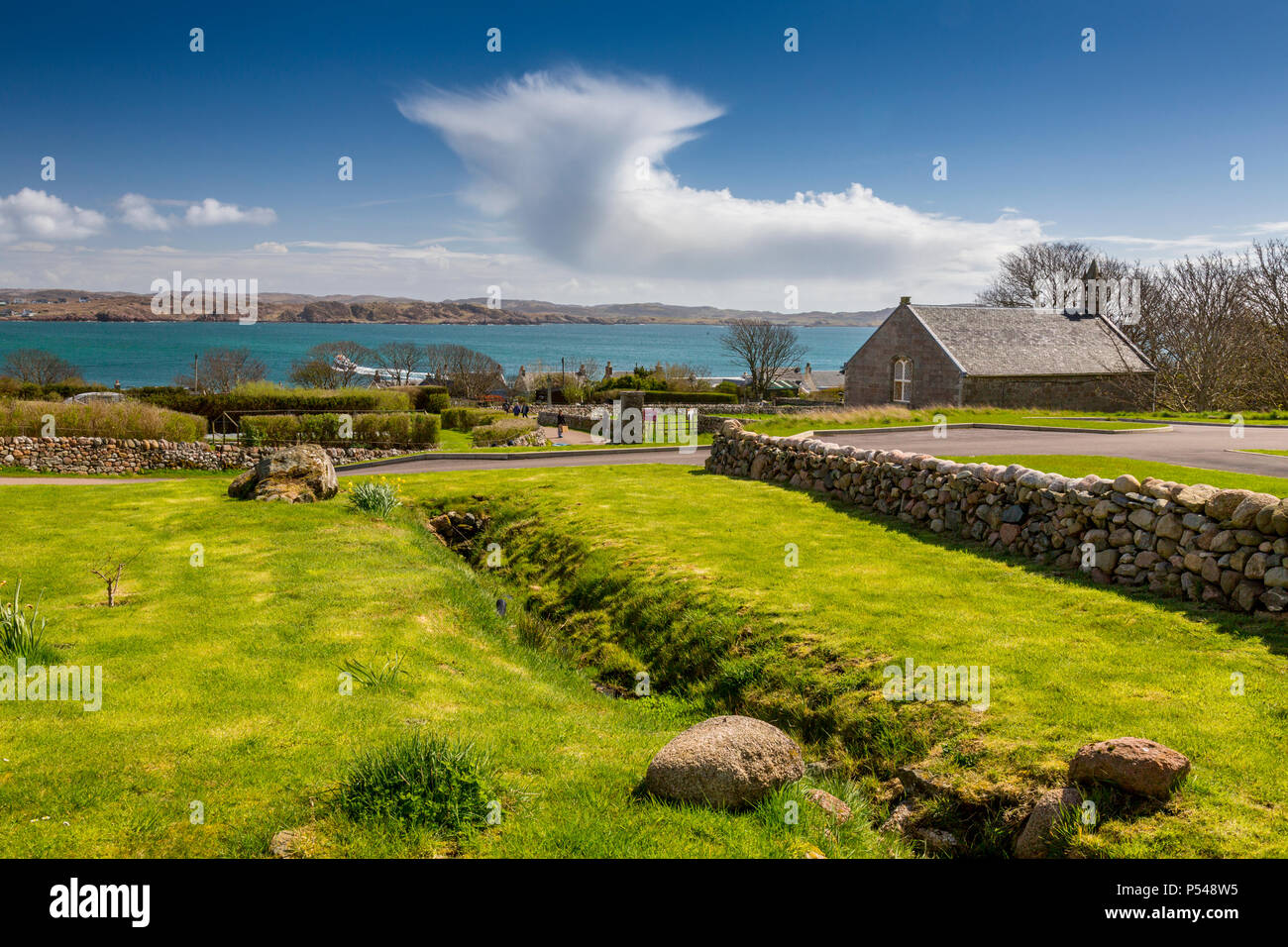 Threatening cumulonimbus clouds over the island of Mull viewed from the Hebridean island of Iona, Argyll and Bute, Scotland, UK - Stock Image