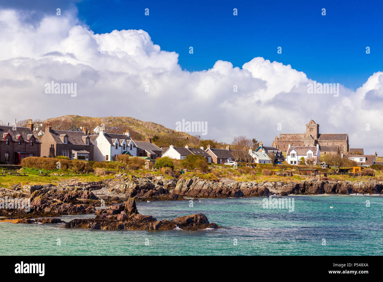 The village of Baile Mor and the historic Abbey church on the Hebridean island of Iona both overlook the Sound of Iona, Argyll and Bute, Scotland, UK - Stock Image