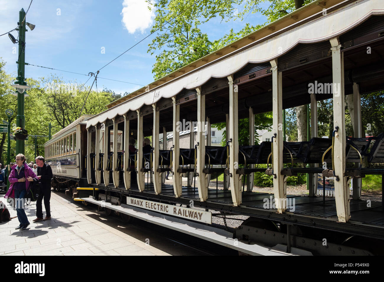 Passengers on platform outside old Manx Electric Railway / Tramway train carriages in the station. Laxey, Isle of Man, British Isles - Stock Image