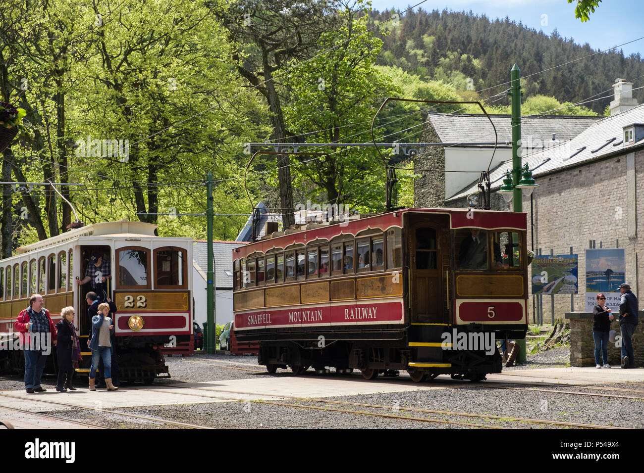 Snaefell Mountain Railway electric railcar carriage number 5 and Manx Electric Railway train 22 in the station in Laxey, Isle of Man, British Isles - Stock Image