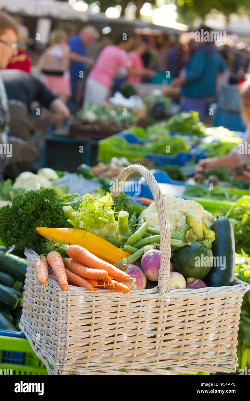 Market, basked full of vegetables - Stock Image