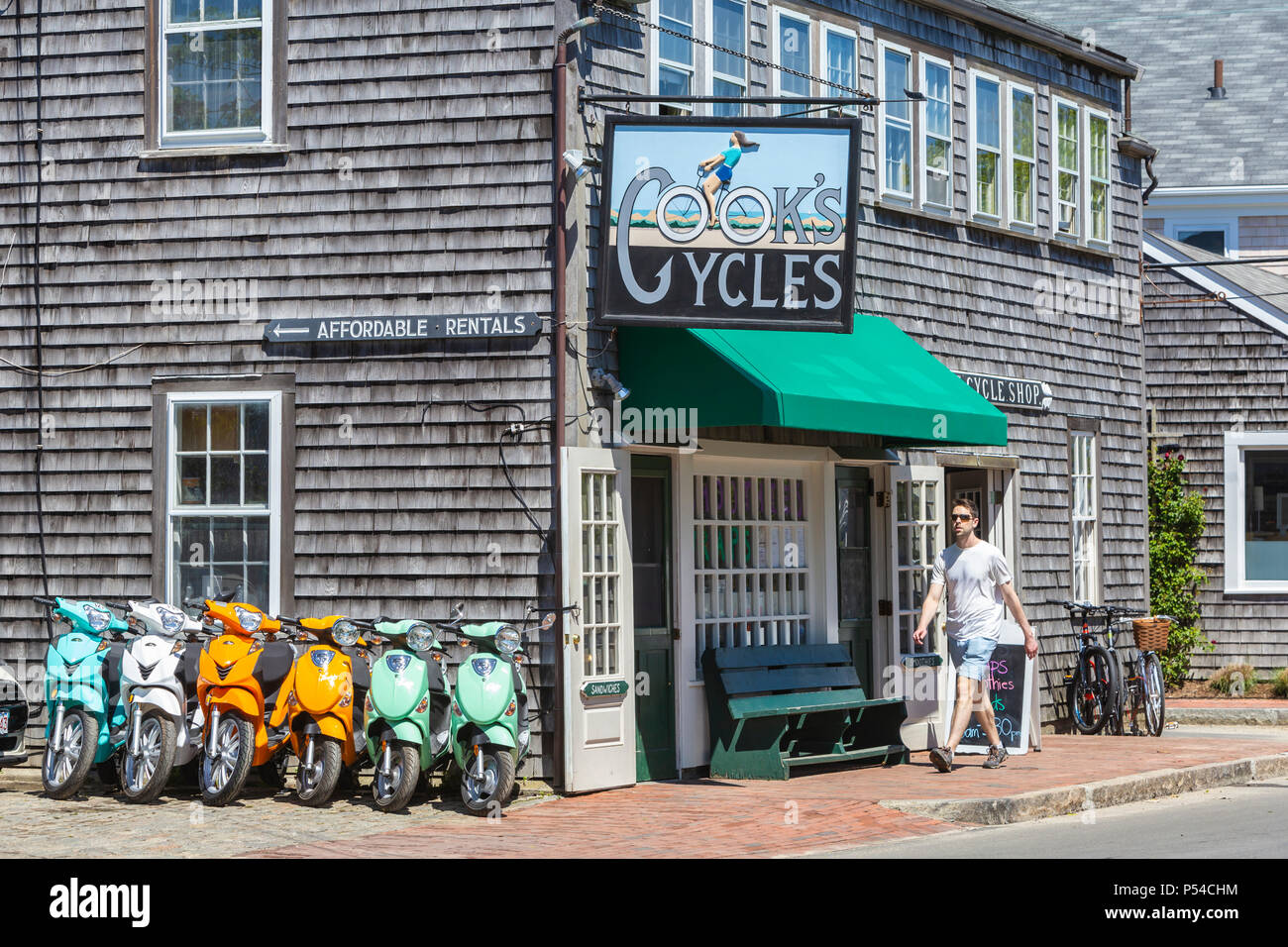 Cook's Cycles, one of a number of shops offering rental bikes and scooters for tourists in Nantucket, Massachusetts. - Stock Image