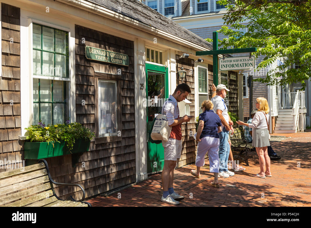 Tourists and visitors get information at the Visitor Center in Nantucket, Massachusetts. - Stock Image