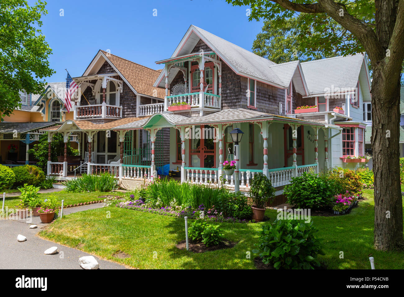 Colorful gingerbread cottages in the Martha's Vineyard Camp Meeting Association (MVCMA) in Oak Bluffs, Massachusetts. - Stock Image