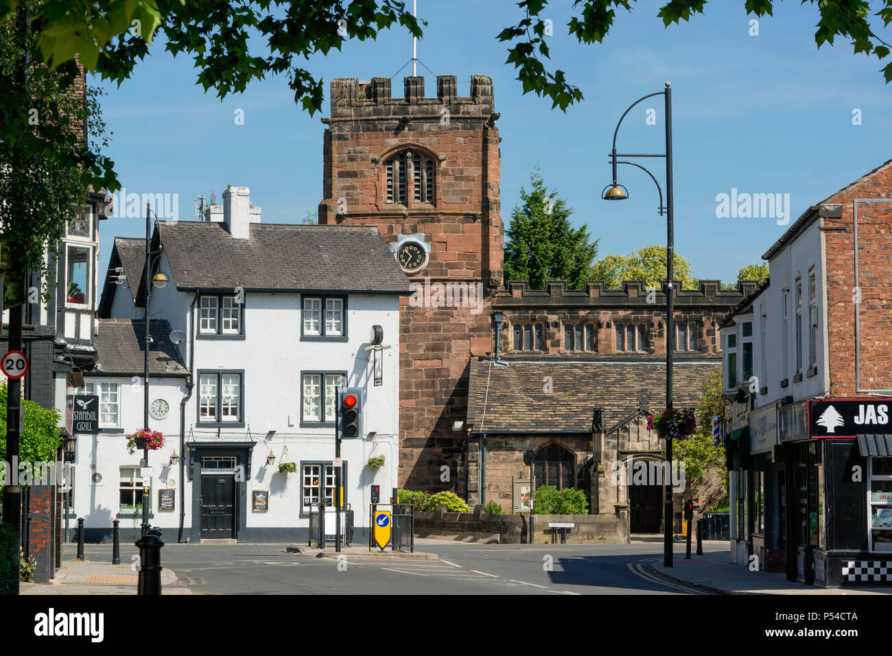The White Hart Tavern and St Mary's Church in Cheadle, Cheshire, UK. - Stock Image