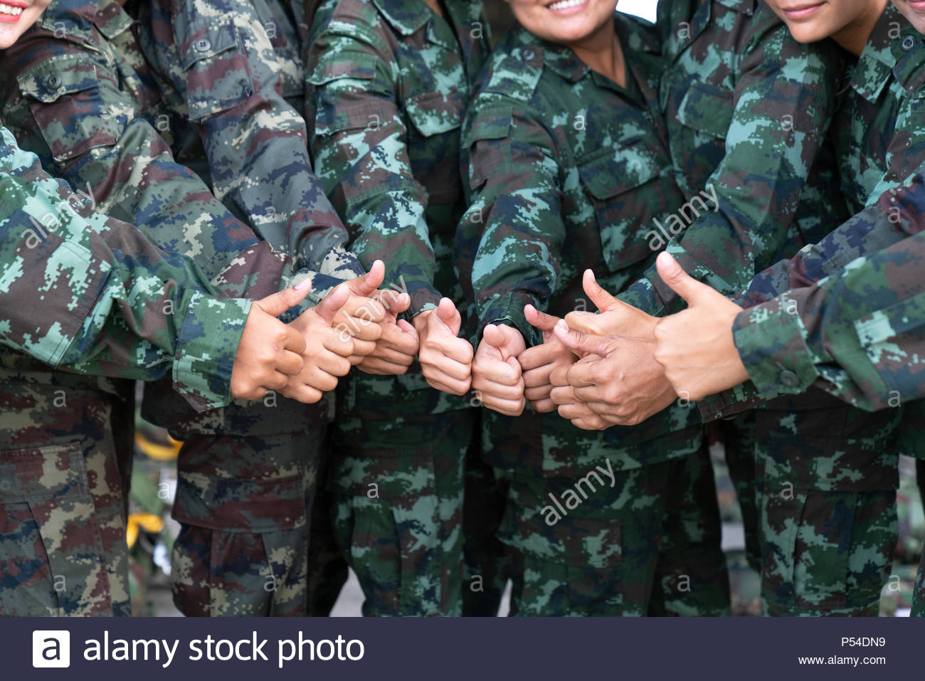 Soldier many thumbs up - Stock Image