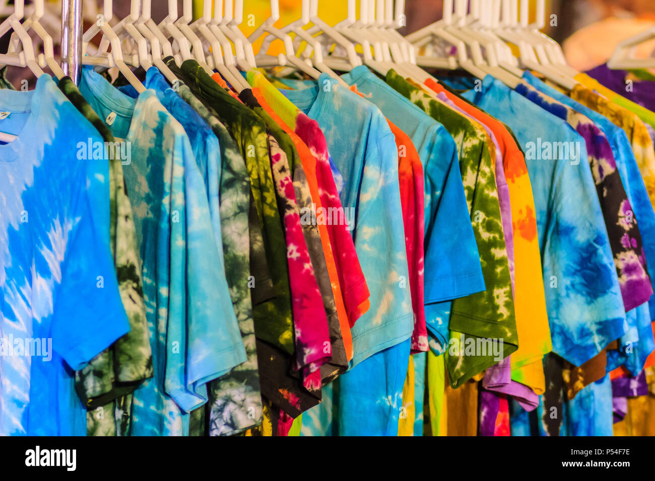 0eeb2bb7 Beautiful Tie dye shirts and fabric for sale in night market at Bangkok,  Thailand -