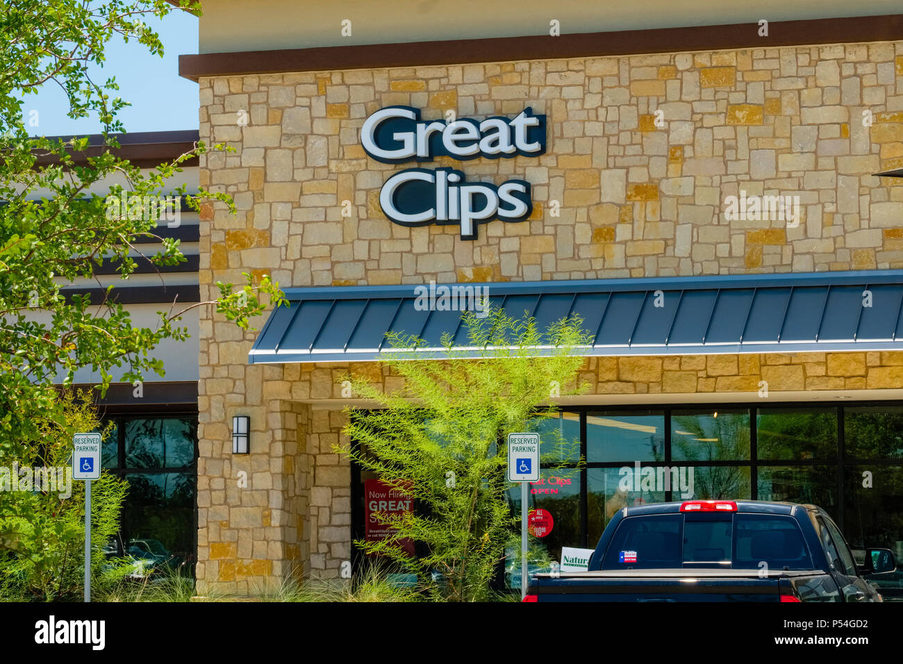Local hair salon and hair care products business store front - Stock Image
