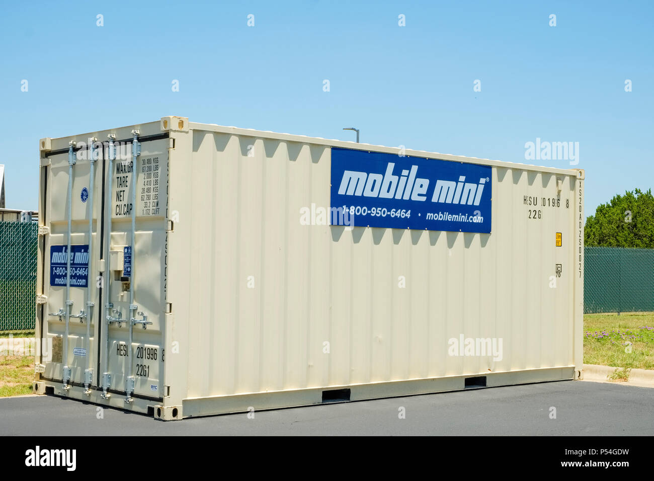 Steel mobile storage shiping container setting outside behind local