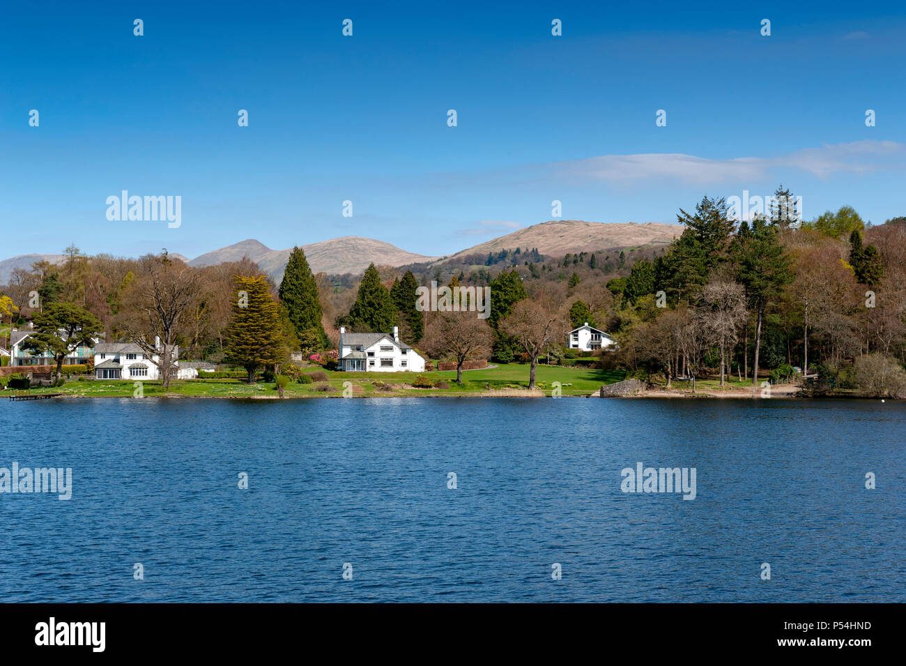 Beautiful lakeside village situated on the bank of Lake Windermere in the scenic Lake District National Park, South Lakeland, North West England, UK - Stock Image