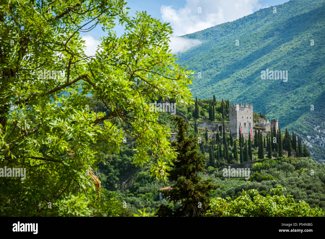 Arco Castle (Castello di Arco) is a ruined castle located on a prominent spur high above Arco and the Sarca Valley in Trentino Alto Adige, northern It - Stock Image