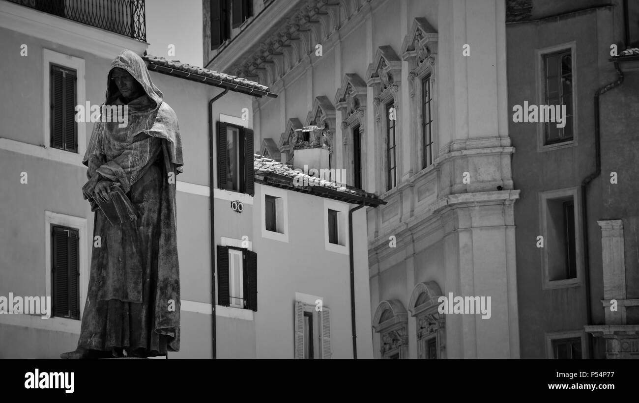 Walking the streets of Rome, street marketplace, statue overlooking the people - Stock Image