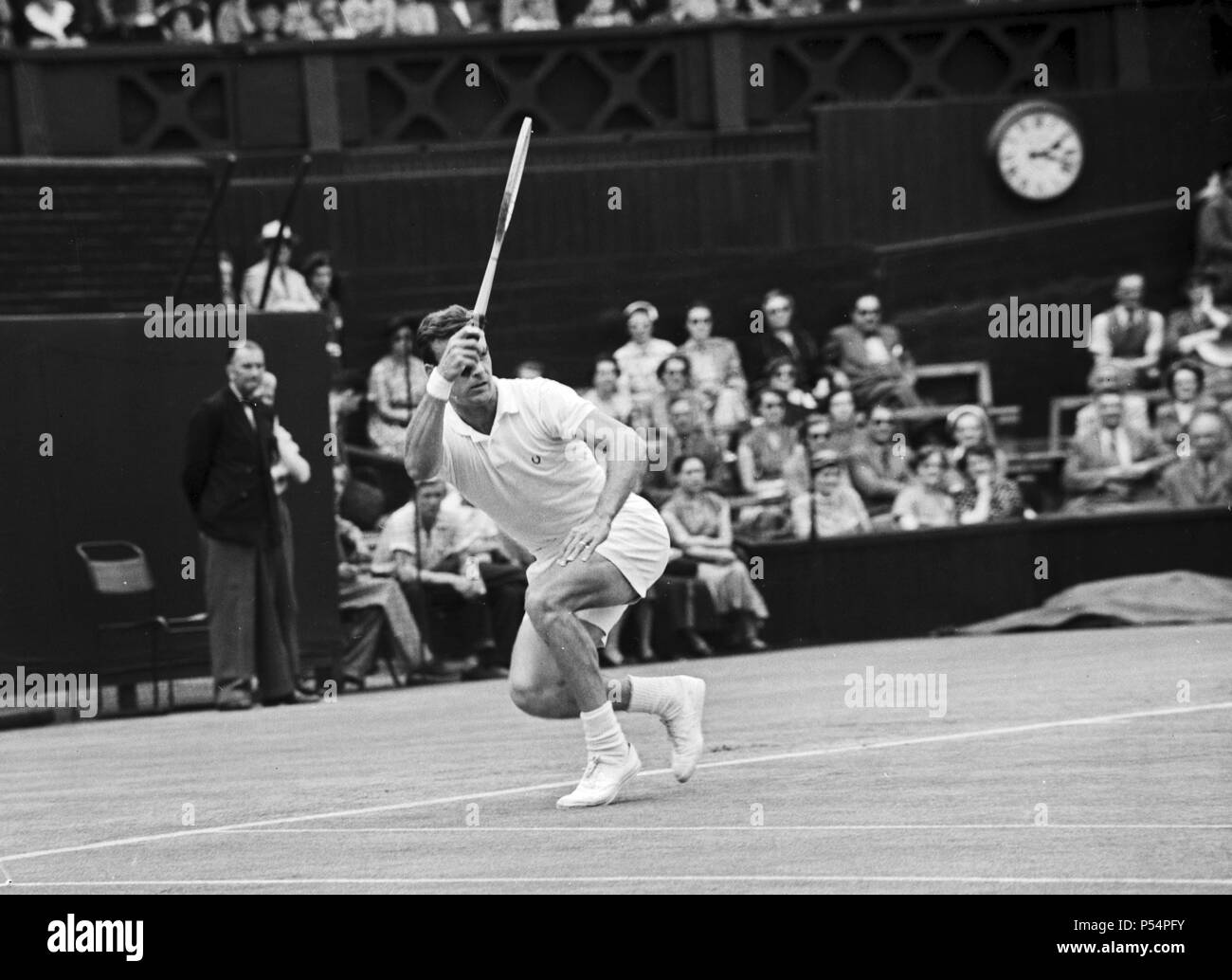Mens Singles action during the Wimbledon Lawn Tennis Championships. June 1953. - Stock Image