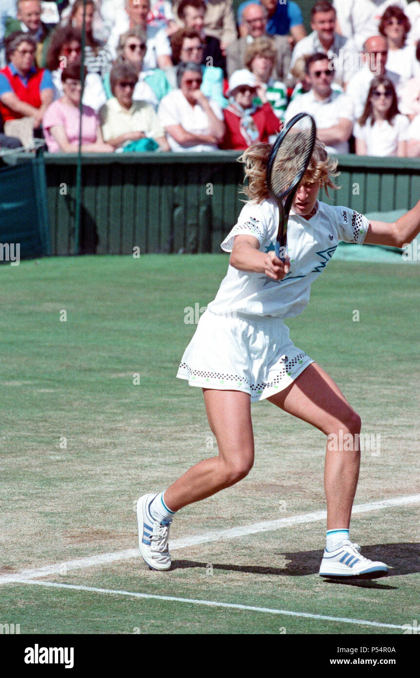 Steffi Graf pictured.  Steffi Graf beats current 6 times defending champion Martina Navratilova, to win the Wimbledon Ladies Singles Final on 2nd July 1988.    After Graf took a 5-3 lead in the first set, Navratilova won six straight games allowing her to win the first set and take a 2-0 lead in the second set. Graf then came back winning 12 of the next 13 games and the match.  Steffi Graf's first of 7 Wimbledon singles title wins. 1988, 1989, 1991, 1992, 1993, 1995, 1996   Picture taken 2nd July 1988 - Stock Image