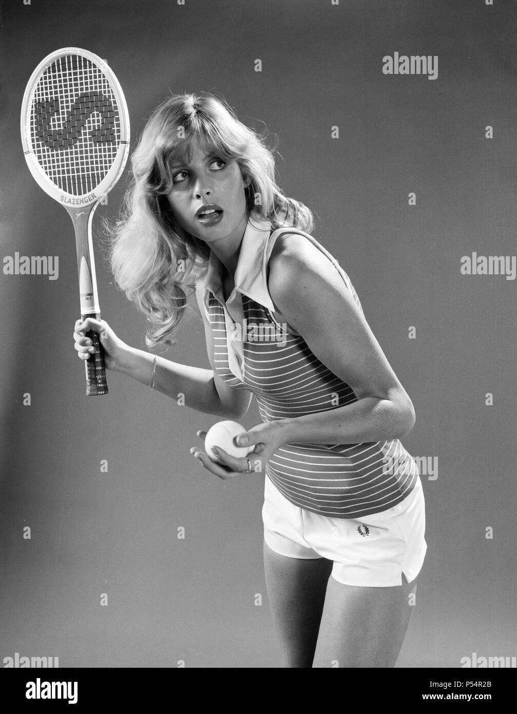 Model Stephane Mclean modelling tennis fashion including shorts by Fred Perry. January 1974. - Stock Image