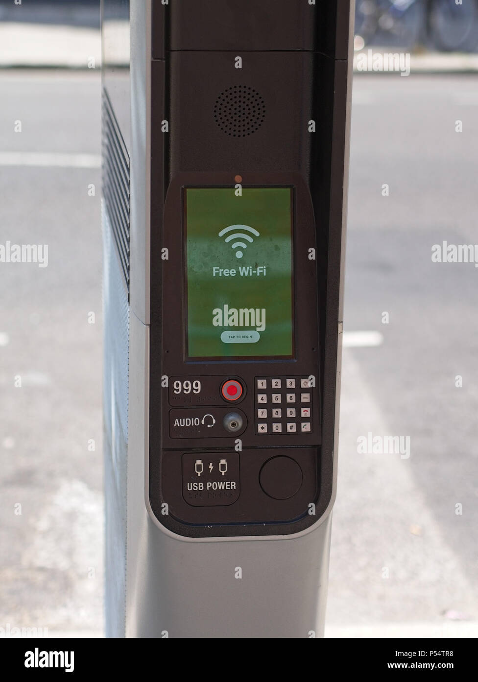 Closeup of London's new kiosks offering free ultrafast Wi-Fi, mobile charging, calls and local information. Digital display showing'Free Wi-Fi'. - Stock Image
