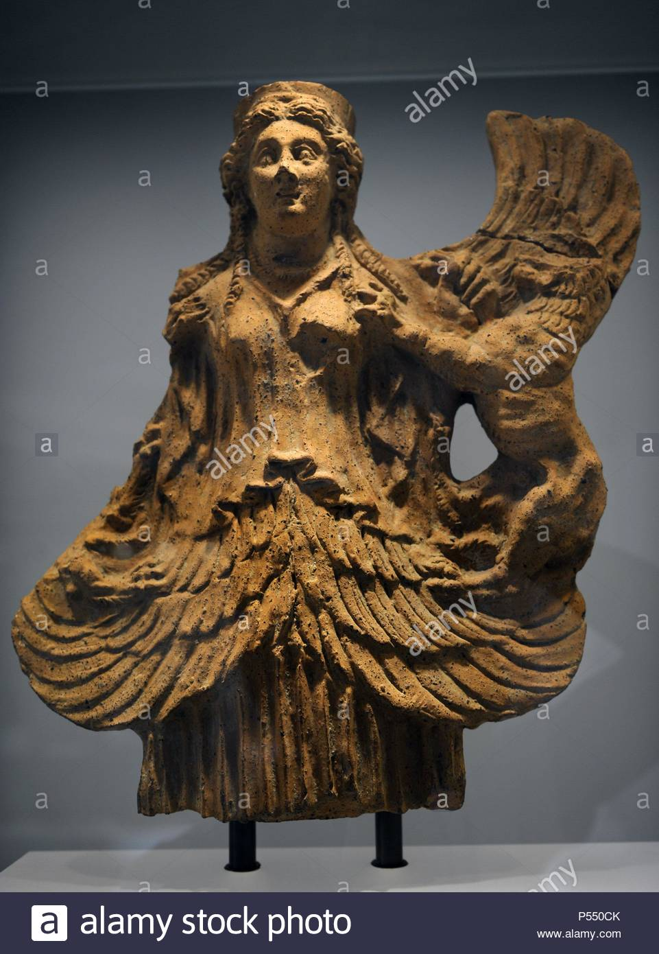 Greek Art. Archaic Period. Winged goddes who tamed wild animals. In this case two lions. Had been introduced into Greece and Italy in the 8th century BC by merchants and itinerants artisans. Terracotta. Ny Carlsberg Glyptotek. Copenhagen. Denmark.. - Stock Image
