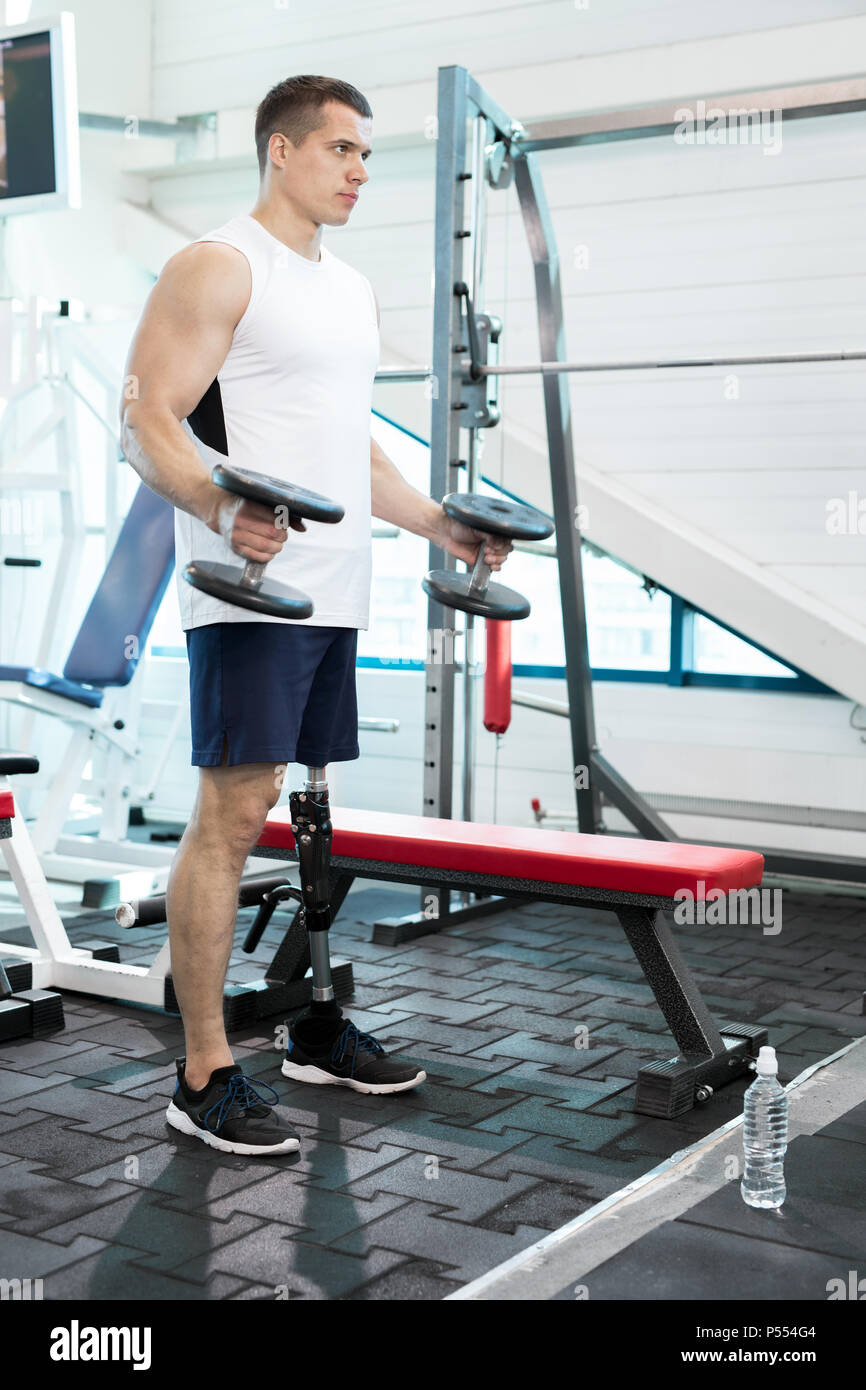 Amputee Man in Gym - Stock Image