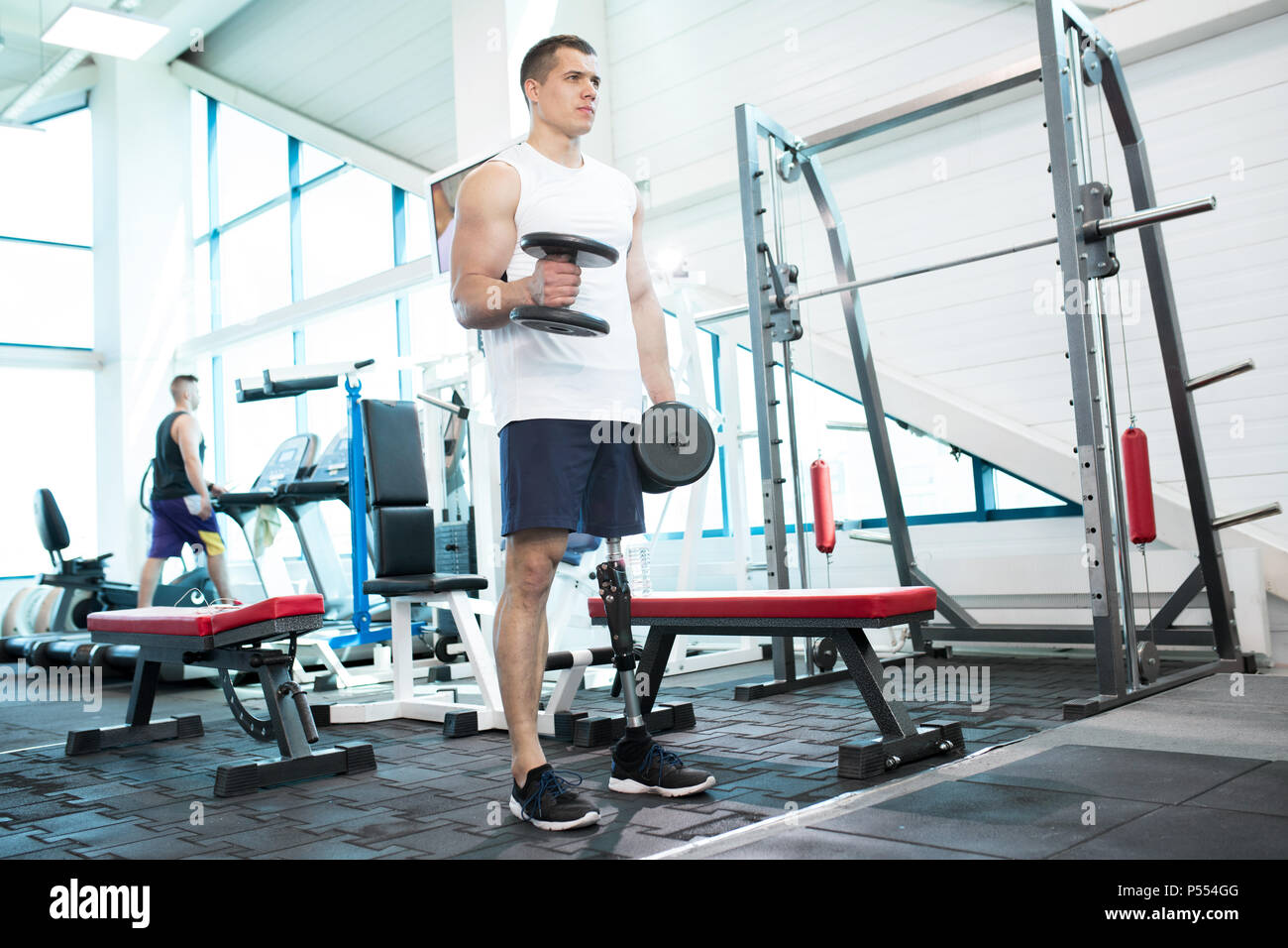 Man with Prosthetic Leg Training in Gym - Stock Image